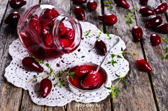 Confiture made of dogwood on a wooden surface in rustic style